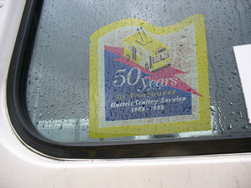 50 years of trolleys! A decal on the side of a trolley bus.