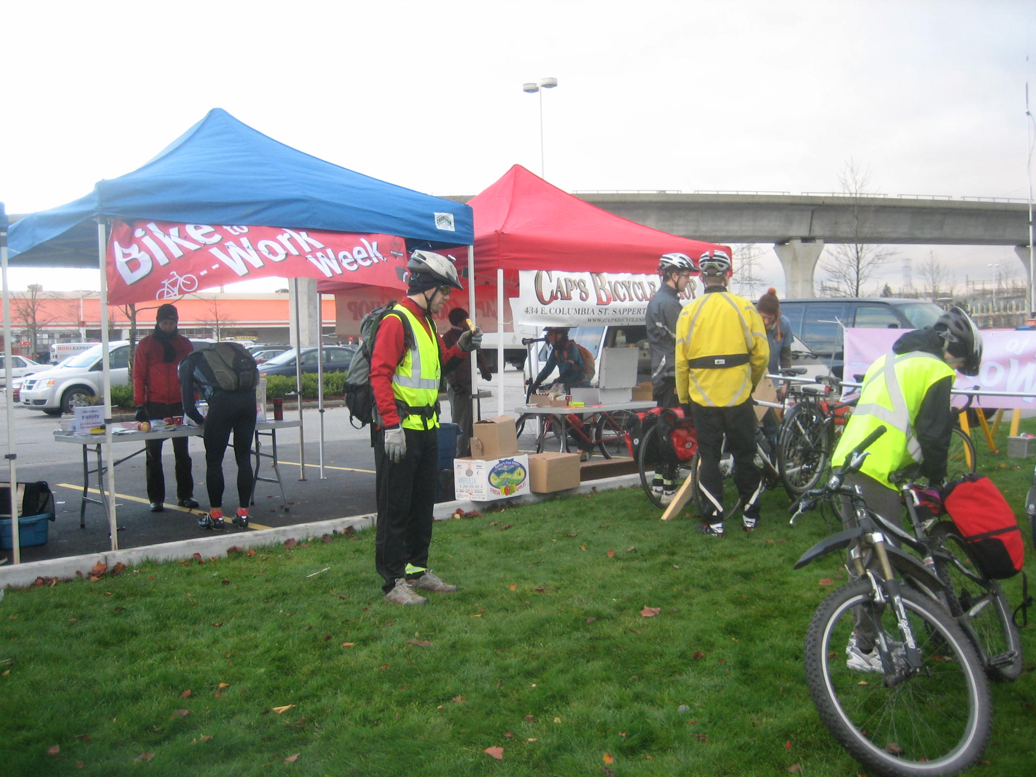 The back of the Gilmore commuter station. Note the tent from Cap's Bicycle Shop, where a bike mechanic is happy to help you out!