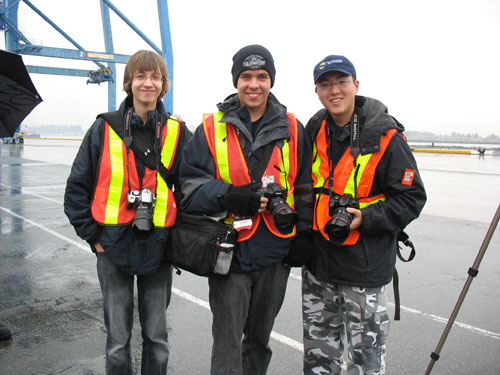 Chris Cassidy, George Prior, and David Lam, the photographers behind Trans-Vancouver. (They\'re wearing safety vests because the docks made us all wear them.)
