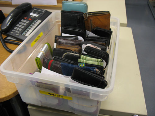 A box of wallets that are waiting to be picked up by their owners.