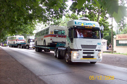 Retired trolleys on a flatbed truck, arriving in Mendoza!