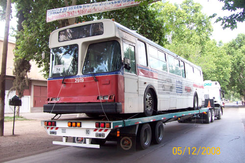 One of our retired trolleys on a flatbed truck, arriving in Guaymallen, Argentina en route to Mendoza.