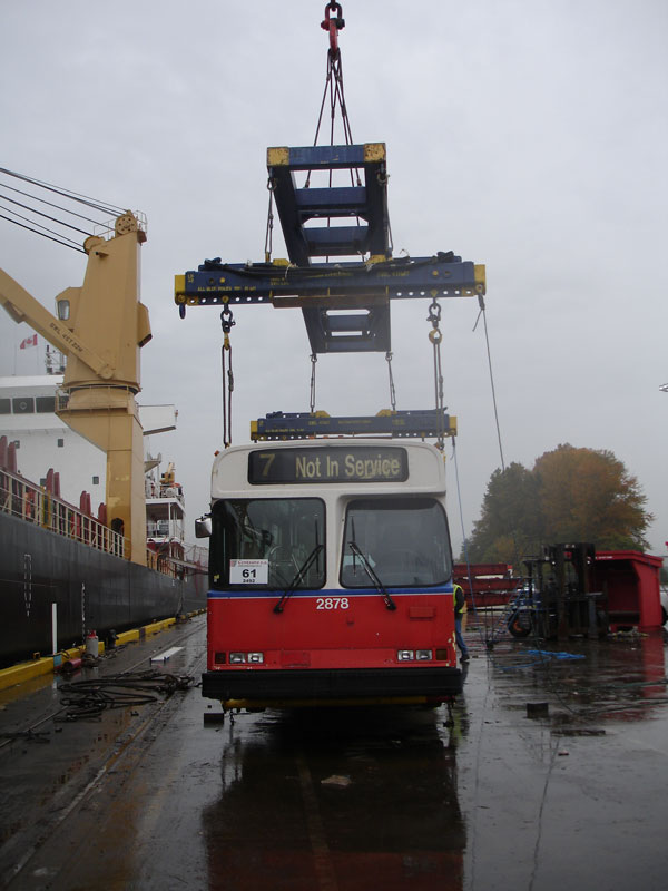 A trolley prepares to be hoisted onto the ship.
