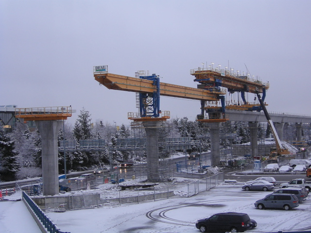 Snow falls as the Launching Truss nears YVR Station.