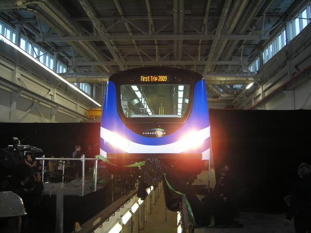 The Canada Line trains are unveiled in the Great Hall of the Operations and Maintenance Centre.