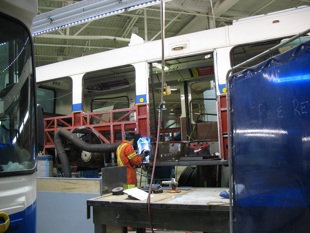 Here's a conventional bus undergoing an overhaul. Welding is being done on the frame to repair a rusted-out element. The red colouring is existing rustproofing provided by the manufacturer.