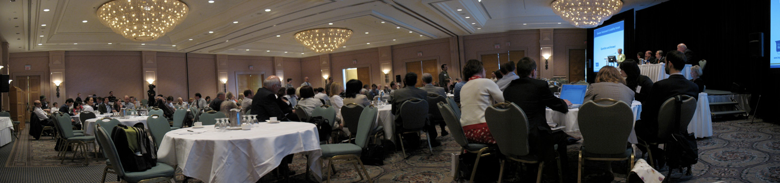 A panorama of the ballroom while people were asking the expert panel some questions.