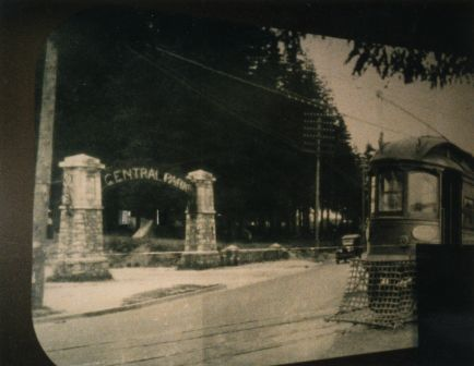 A Central Park Line  interurban tram going by the actual Central Park – check out its original gate at the Kingsway entrance! (Item 145-010, from the Evelyn Salisbury collection, courtesy of the <a href=http://www.heritageburnaby.com>City of Burnaby Archives</a>.)