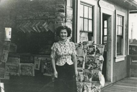 Margaret Thould in front of her family's store in Highland Park Station on the Central Park Line, 1935. Item 204-628 from the Mayor's Office fonds, courtesy of the <a href=http://www.heritageburnaby.com>City of Burnaby Archives</a>.