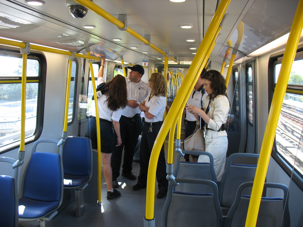 A few SkyTrain attendants took a moment to examine the new maps.