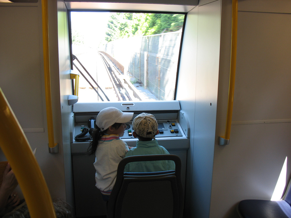 The first junior SkyTrain pilots aboard train #306! In the early part of the ride, the train had more SkyTrain and TransLink people onboard than actual passengers -- the kids above were a few of the lucky riders!