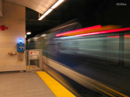 A Canada Line train breezes by Oakridge-41st Avenue Station. Photo by <a href=http://www.flickr.com/photos/stchou/3838672096/in/pool-canadaline>Steve Chou</a>.