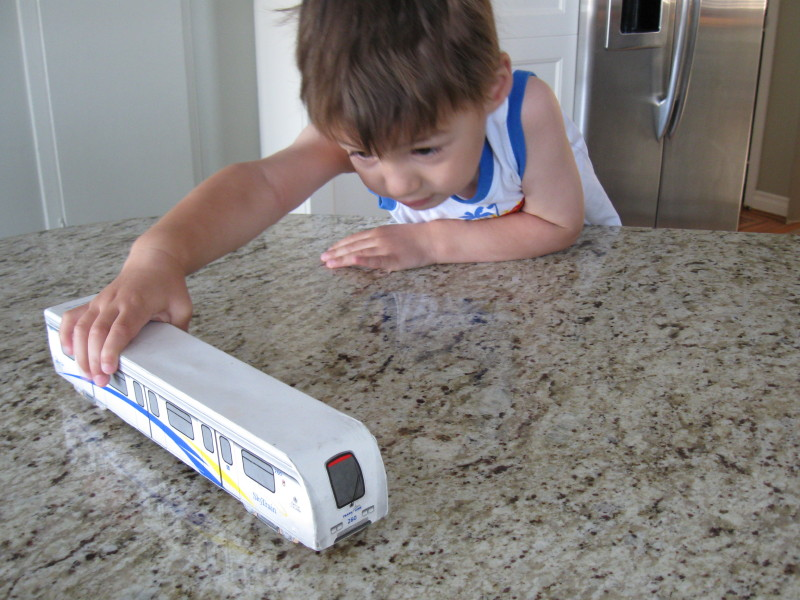 Lucas with his new toy SkyTrain.