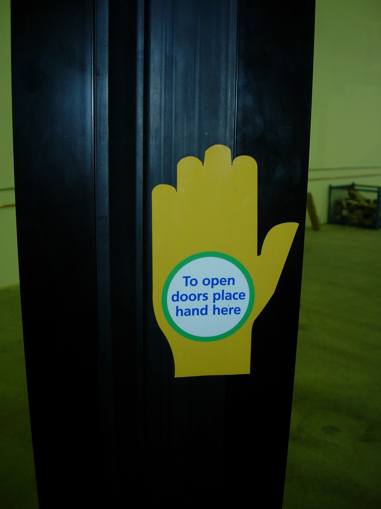 The new Nova hybrid buses have new stickers to help you open the door. It's like giving the bus a high-five! :)