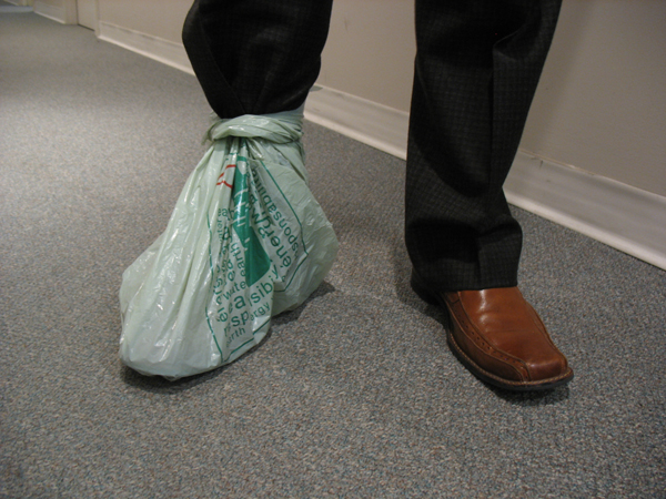 Plastic bags can be used to cover your shoes in a pinch. Wrap the handles of the bag around your ankle and secure it with an elastic band.