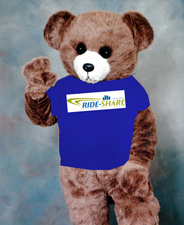 An artist's rendition of the Ride-Share bear wearing his Ride-Share t-shirt. Silly bear!