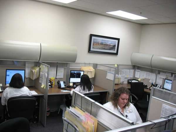 Reviewers at the Quickpass office examine license plate photos flagged by the system.