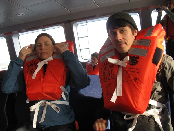 Two of TransLink's staff model the life vests.