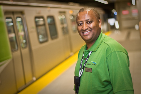 CLAs wear this distinctive green in their uniform. You'll see them on the Canada Line.