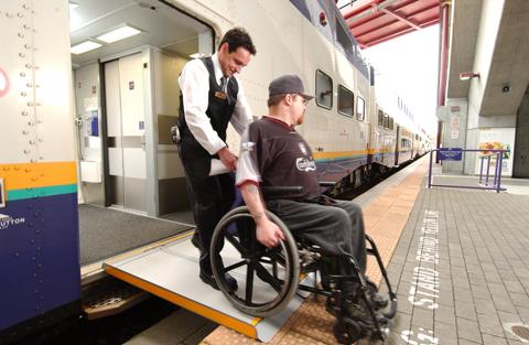 A West Coast Express conductor assists a customer.