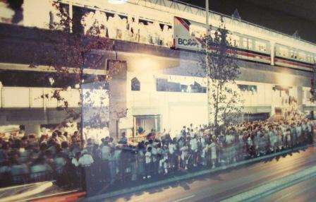 Passengers line-up outside Main Street SkyTrain Station during Expo 86.