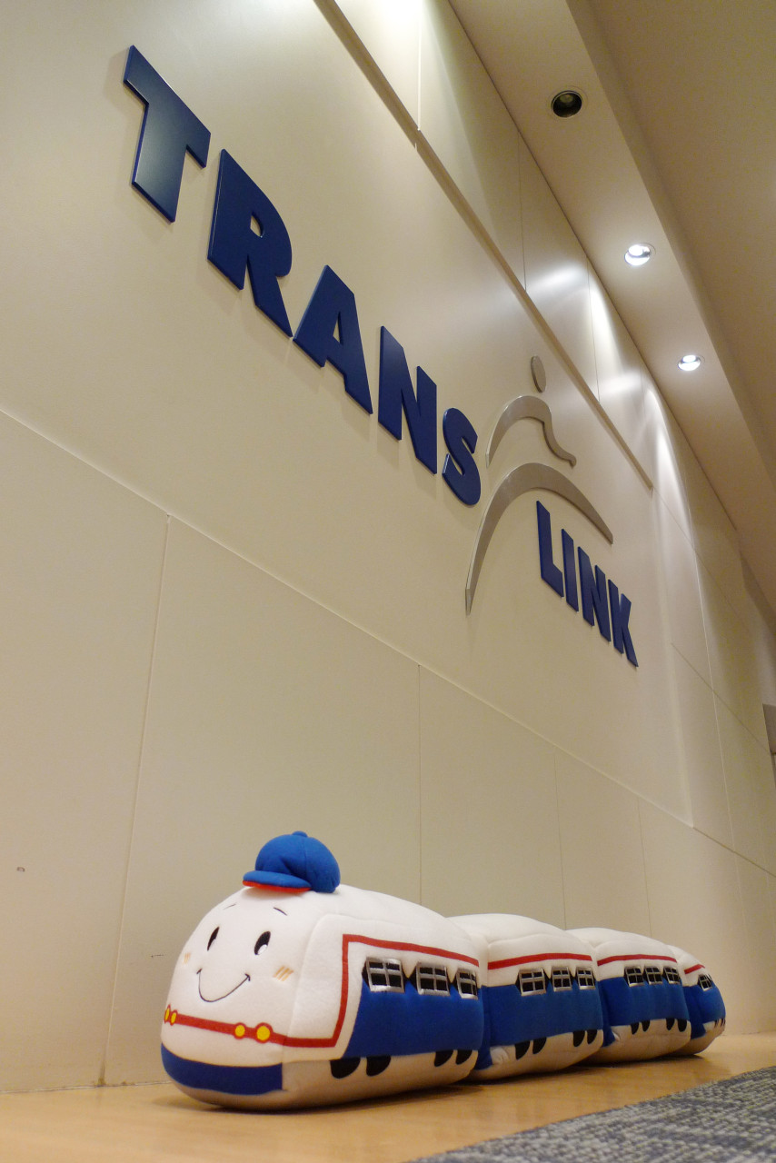 The Bangkok SkyTrain next to the TransLink logo in our front office hallway!