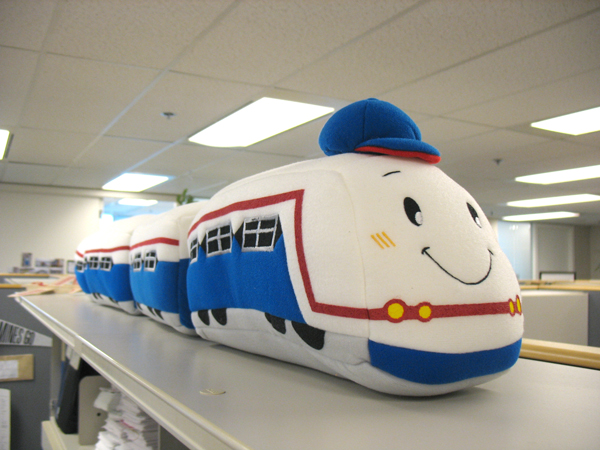 The plush SkyTrain from Bangkok's transit system, atop my overhead filing cabinet!