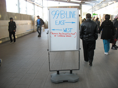 Signage at Broadway-City Hall to help people get to UBC on the westbound 99.