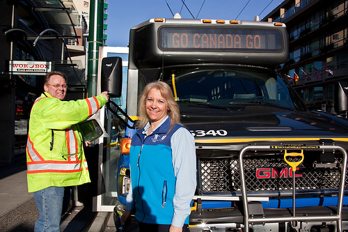 Gord replacing a mirror for Mary, Community Shuttle Operator