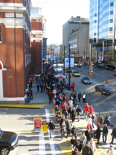 Crowds headed to the flame and to SkyTrain services.