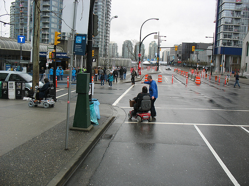 On the street, at the accessible dropoff point for Canada Hockey Place.