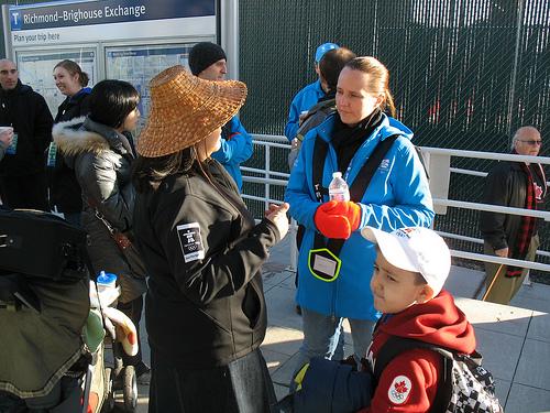 Transit host Belinda helps out a customer.