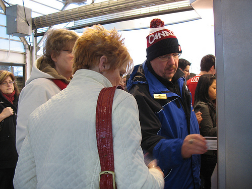 Mike helping out some new riders buy tickets for West Coast Express.