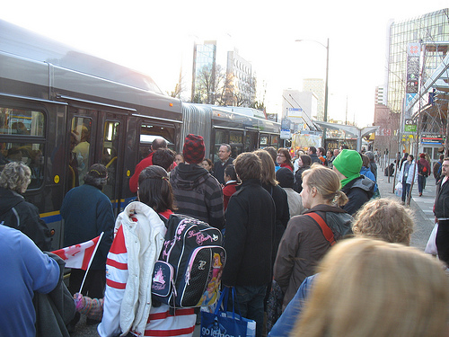 Riders board the westbound 99 B-Line at Cambie on Tuesday, February 16.