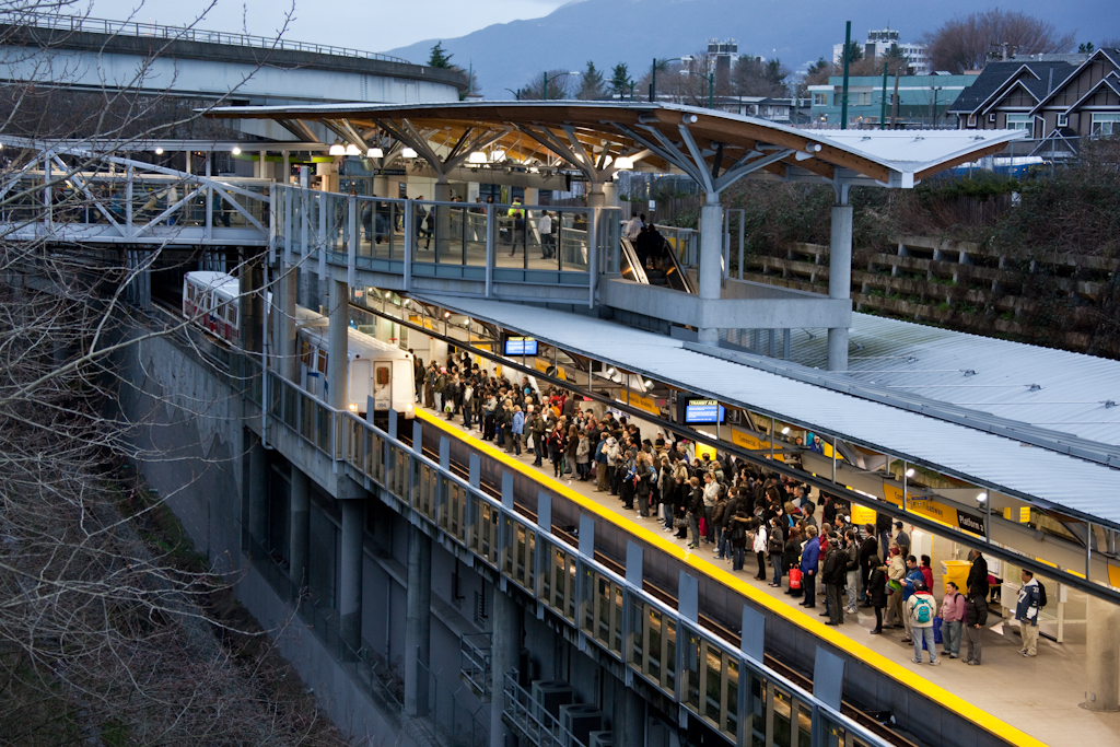 Crowds wait for Millennium Line trains at Commercial-Broadway Station on Friday, February 12.