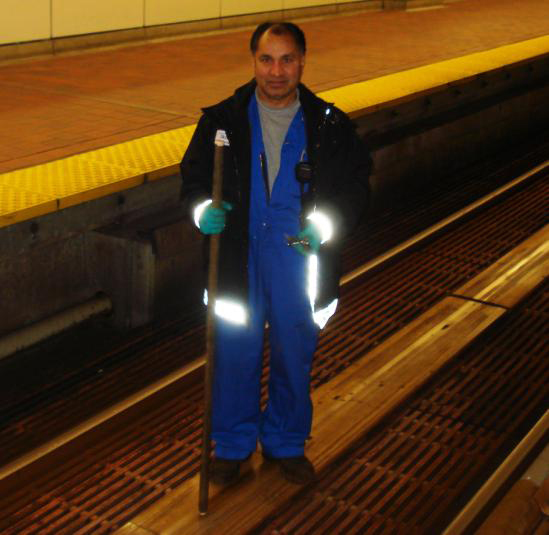 Surge Gill, Guideway Technician, 'tapping' LIM panels.