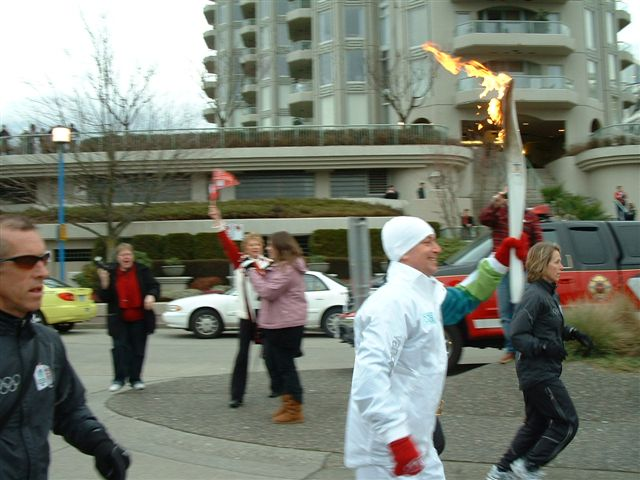 The Olympic torch speeds past the north SeaBus terminal on Lonsdale Quay!