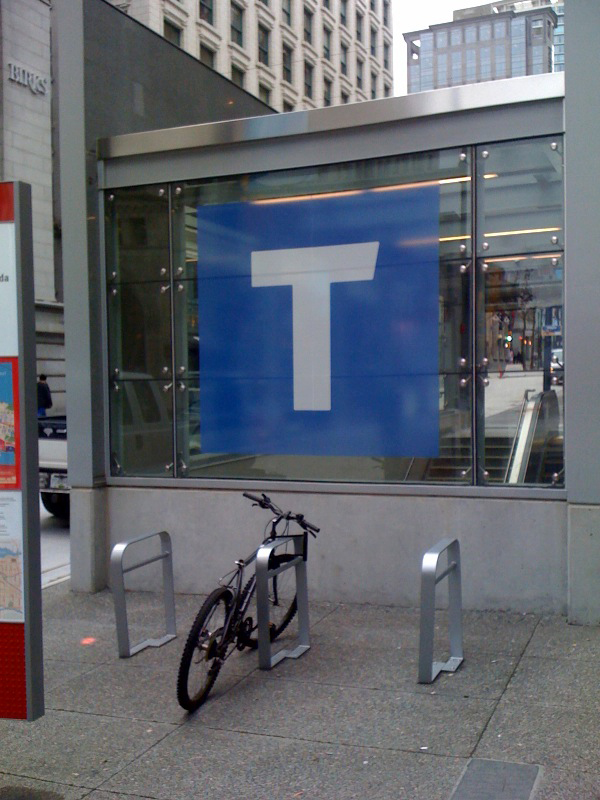 T wayfinding signage up at the Waterfront Canada Line entrance on Granville Street.