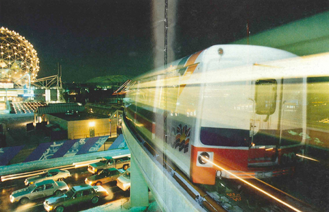 Ghostly SkyTrain soars above Vancouver! From the cover of the SkyTrain Flight Plan leaflet.