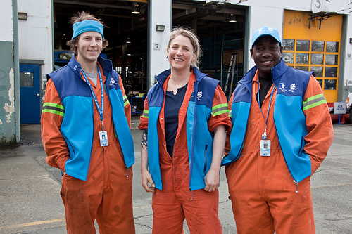 OTC SWT mechanics Marie, Curtis, and Omar in their Olympic gear. Photo by Charlotte Boychuk.