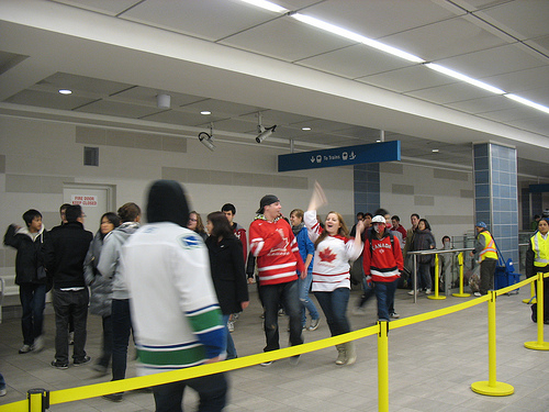 Happy people coming off the Canada Line at Vancouver City Centre.
