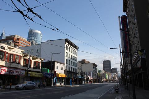 A photo from last week's trip out to Granville Street. Here is the trolley wire from Davie at Granville, terminating at one pole on the right, since there's no wire running up the street yet.