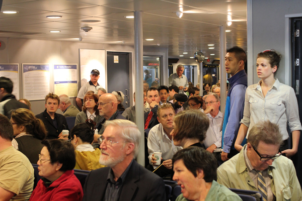 Most seats on the new SeaBus were full, stretching through the centre aisle all the way to the other side.