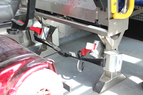 The seatbelt and straps on a trolley bus.