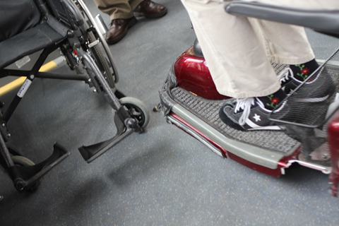 The scooter just brushes by the wheelchair!