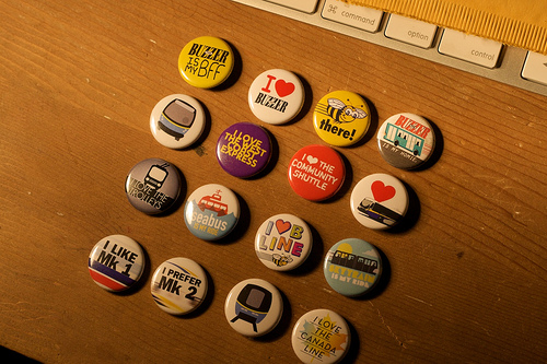 The complete set of transit buttons we have on hand. Photo by <a href=http://www.flickr.com/photos/grahamb/4252670723/in/set-72157623157537026/>Graham Ballantyne!</a>