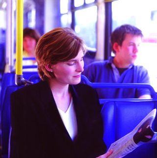 woman_on_bus_reading