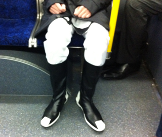 A costumed commuter