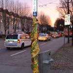 A dressed up bus pole