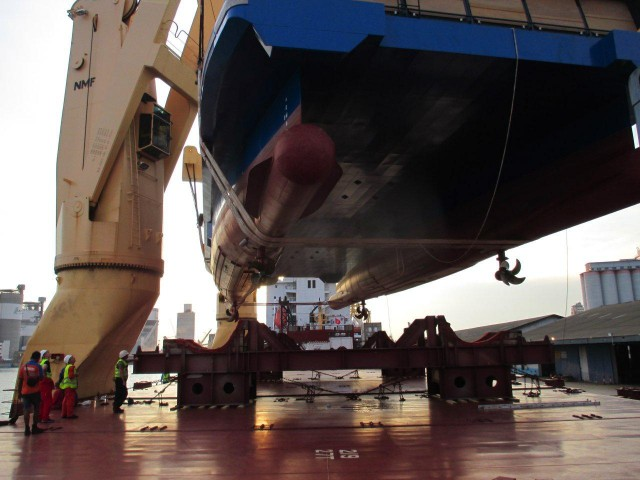 Then, she gets lowered onto the cargo ship